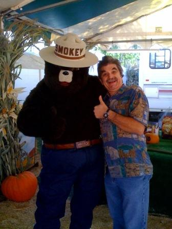 Tom with SMOKEY BEAR...no the...ya hear!